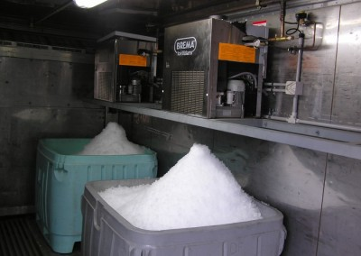 Flake ice machine refrigerated container