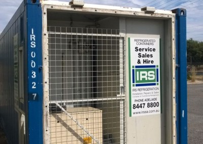 shipping container converted to have the motor mounted outside but not accessible. Guarded by a lockable mesh Gate and side mounted lockable sliding door