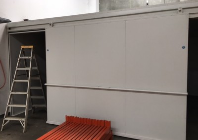 A sliding door being installed to allow for maximum access in a commercial cool room in Adelaide