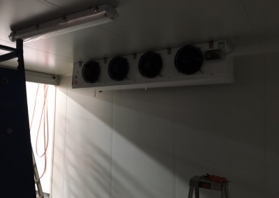 Banks of exhaust circulation refrigeration fans being installed in a purpose built coolroom in Adelaide