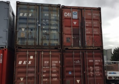 A stack of Secondhand 20' shipping containers varying prices
