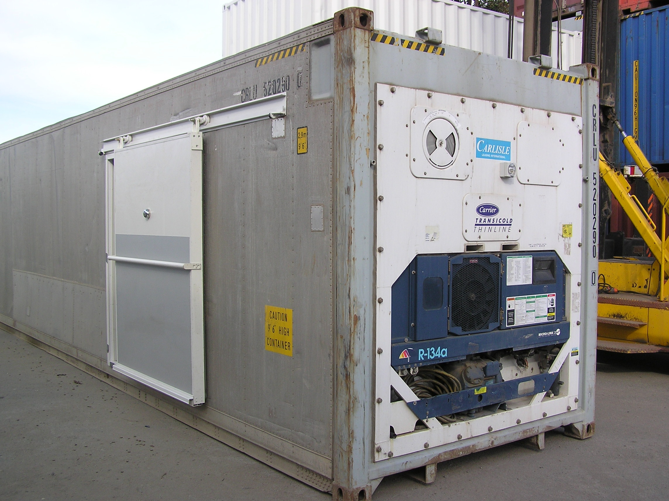 40' Container modified to provide refrigerated temperature controlled environment for food storage and transport. Sliding side access doors.