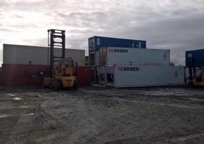 IRS ability to handle the logistics of moving shipping containers quickly is a big advantage . This photo shows two different sized fork lifts moving shipping containers