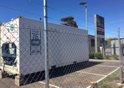 IRS Refrigerated shipping container hired and made secure with temporary cyclone fencing